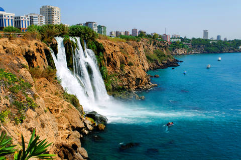 Photo of the Antalya Turkey waterfall showing city on cliff and ocean below
