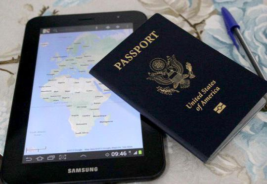 New United States passport book and tablet showing map of Africa and Europe.