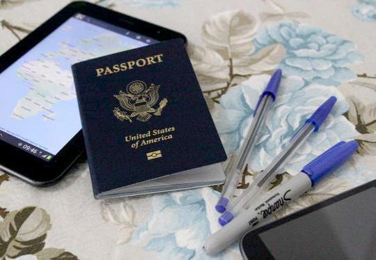 U.S. Passport with tablet, smartphone and pens.