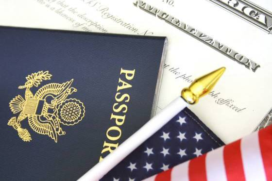 Certificate of Naturalization, U.S. Passport and American Flag