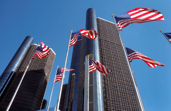 American Flags near downtown detroit buildings