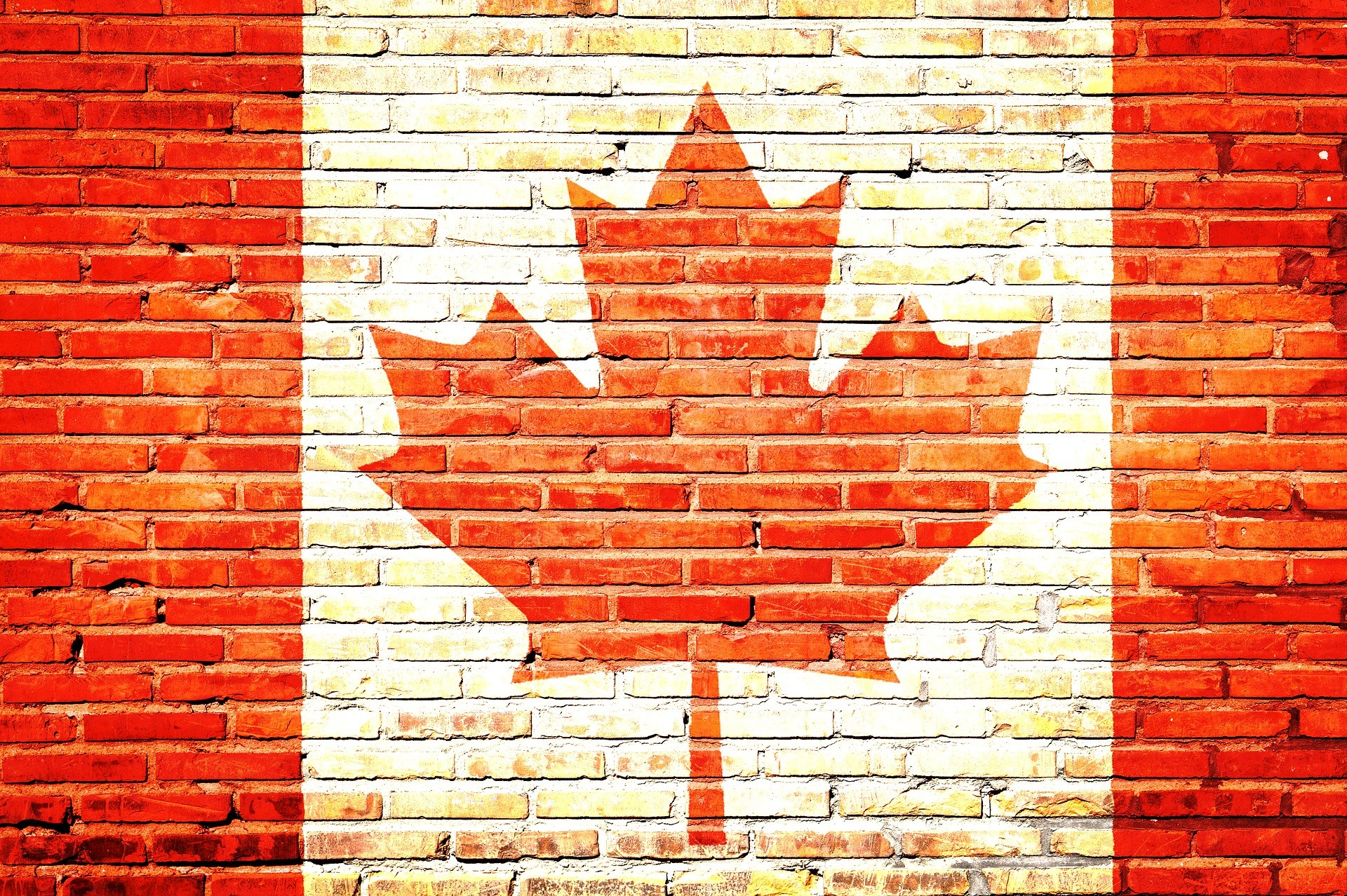 Canadian flag mural painted on a brick wall