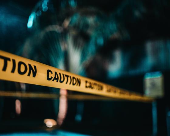 caution tape across a night scene