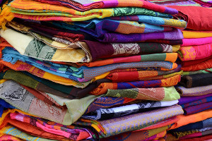 a stack of colorful fabric and textiles