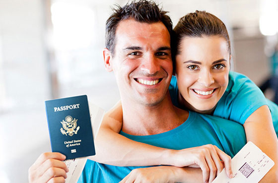 Happy couple holding passports