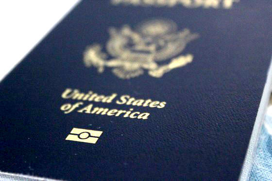 Close up of front cover of blue United States passport book