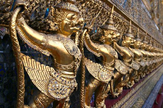 A row of gold sculptures at Bangkok's Royal Palace