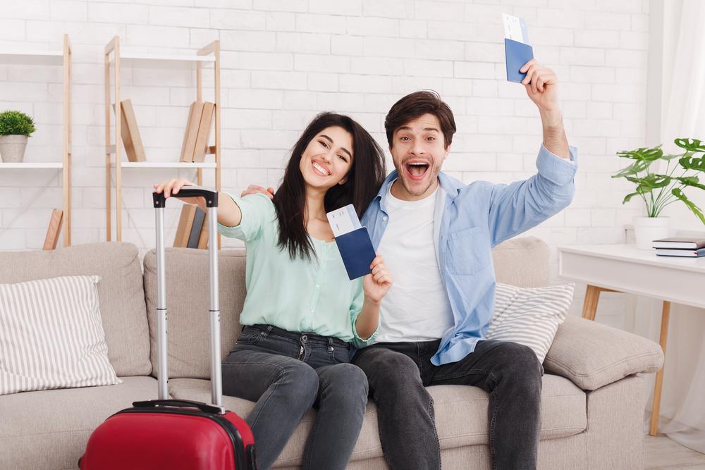 Happy couple with passports