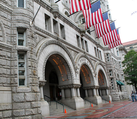 Old post office with row of American flags