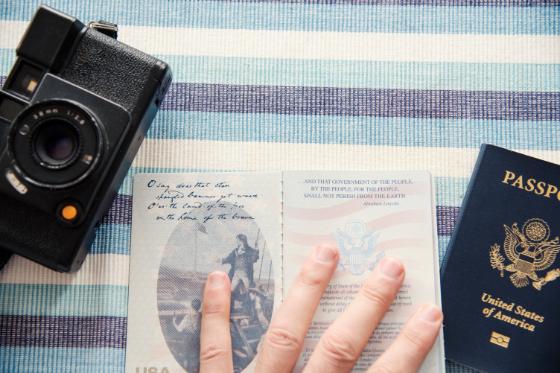 open passport book next to a camera