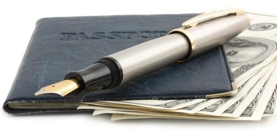 Passport cover, pen and money