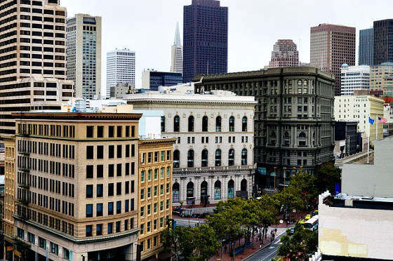 San Francisco buildings with American flag flying on right side.
