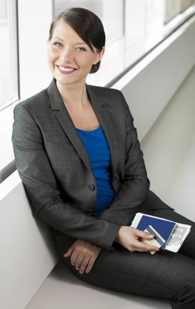 Traveling businesswoman with passport in hand