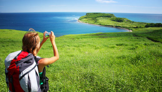 Young woman traveler taking pictures