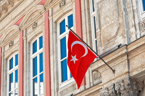 Flag of Turkey hanging in front of old building in Istanbul