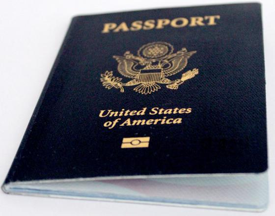 Front of U.S. passport book with epassport symbol.