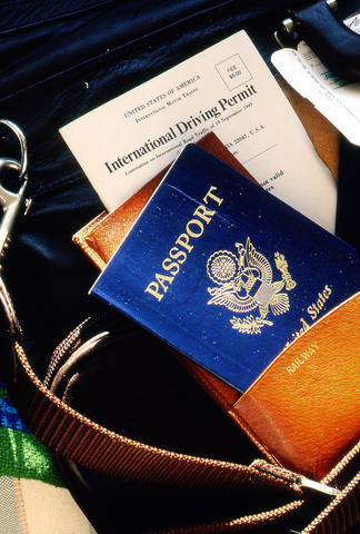 United States passport and international driving permit in travel bag