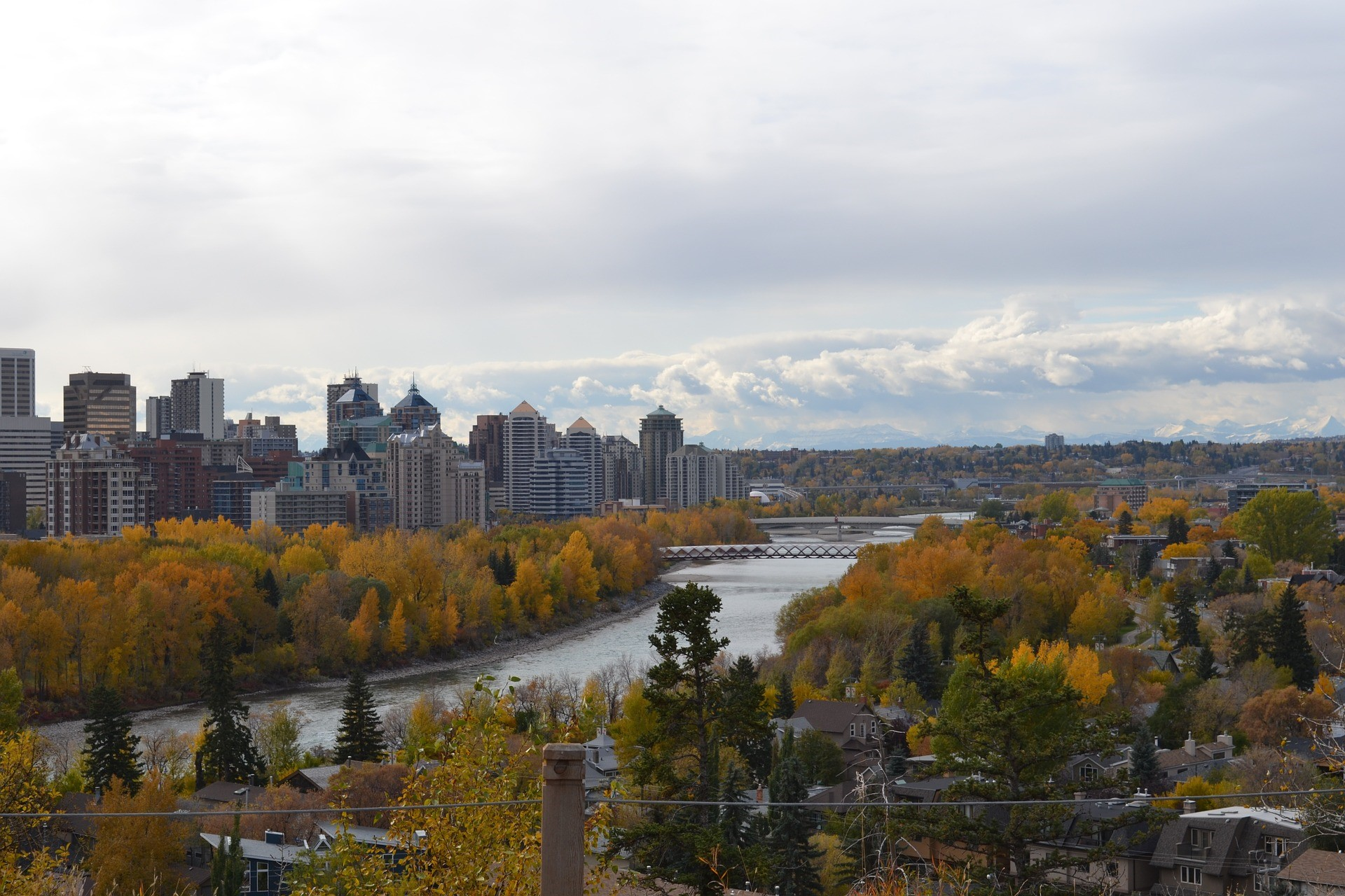 a view of the Calgary, Alberta skyline and Bow River with fall foliage