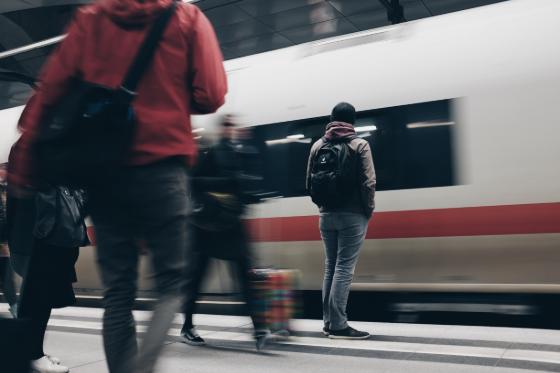 man waiting on a train platform