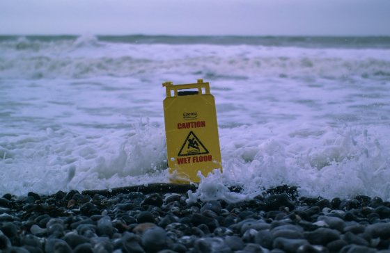 a wet floor sign in the ocean