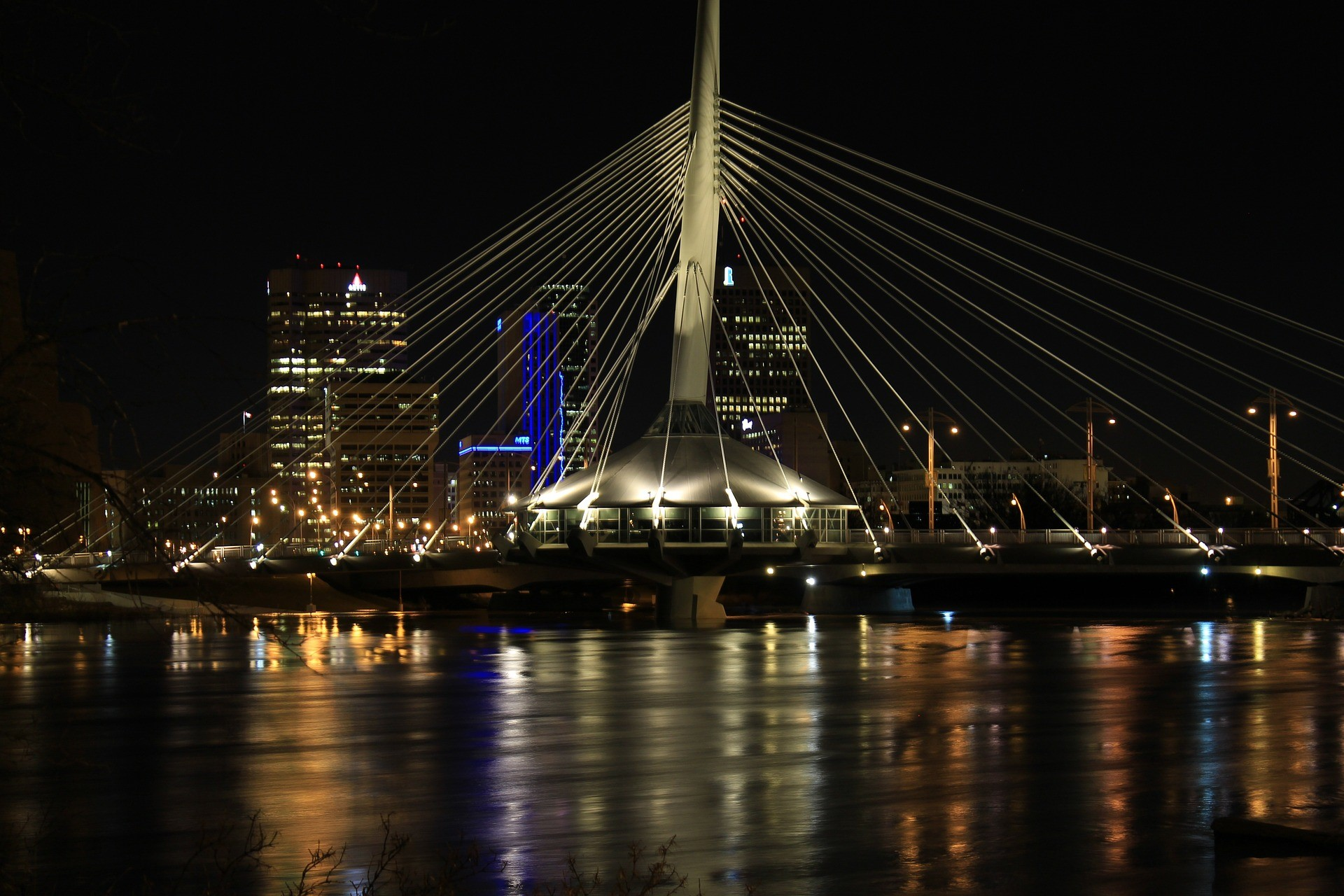 A view of the Provencher Bridge and Winnipeg skyline at night