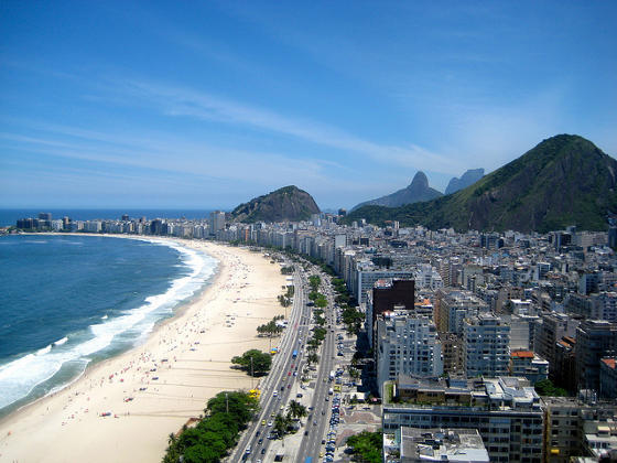 Copacabana beach in Rio de Janeiro with famous Sugarloaf mountain in background.