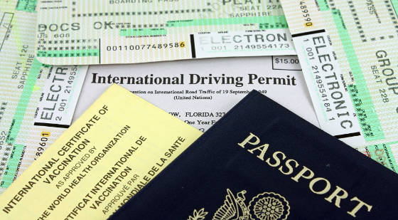 IMportant travel documents including a U.S. passport, immunization card, boarding pass and international drivers license