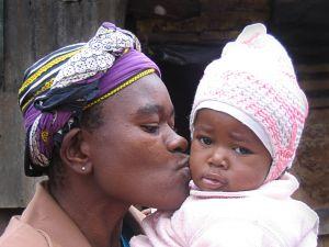 Kenyan Kiss: Grandmother kissing grandaughter.