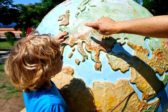 Minor choosing travel destination on world map