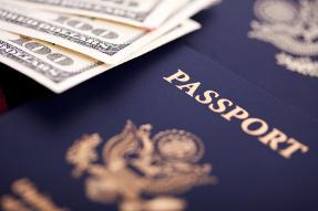 New U.S. Passport and 100 dollar bills