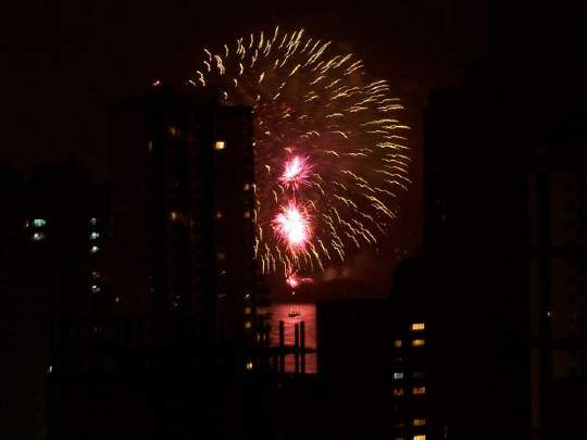 Burst of red and yellow lights as fireworks explode on New Year's Eve in Brazil.