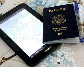 United States Passport, Samsung tablet and pen on table.