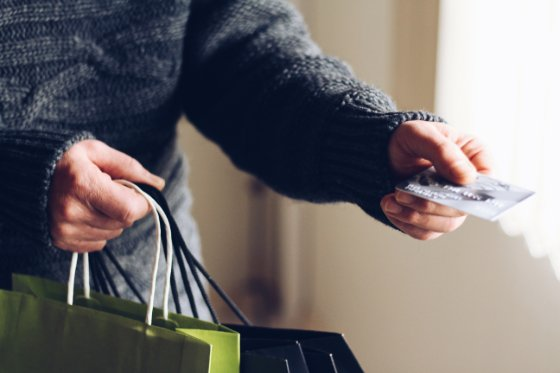 paying with shopping bags