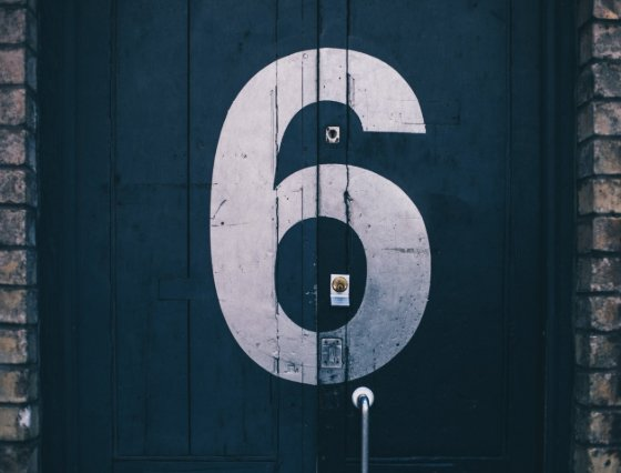 six painted on a door