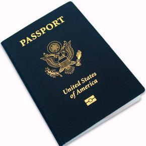 Front cover of new U.S. passport with emblem of United States and biometric symbol.