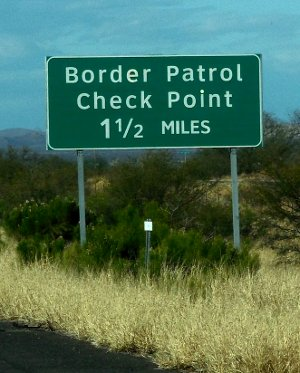 Green US border inspection station road sign
