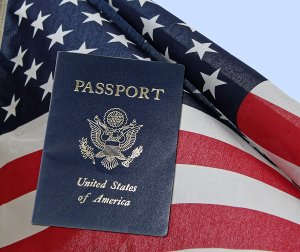blue US passport in front of American flag