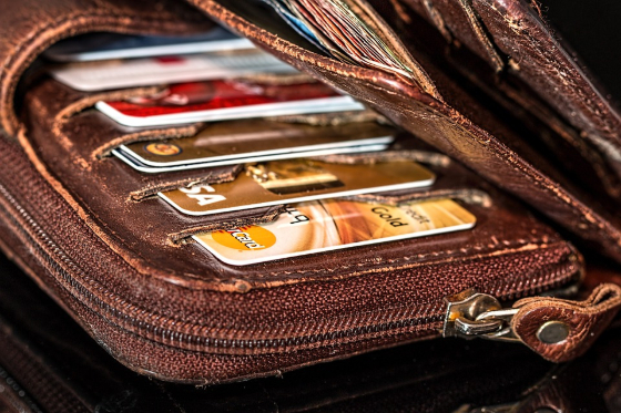 a leather wallet with seeral credit cards inside